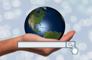hand holding a globe meaning that http websites are less secure than https ones